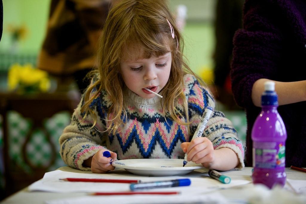 Girl making Willow Pattern Plates